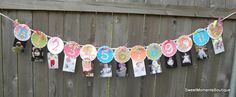 FAB idea.  A 1st birthday party idea that features a picture for each month of his/her first year.