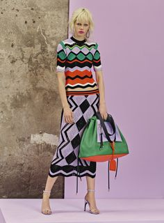 "wgsn: ""Versace Resort 2018: This striking use of colour, with global pattern influences make this design stand out. The knit is actually graphic lace with a sporty modern influences, and offered up in..."