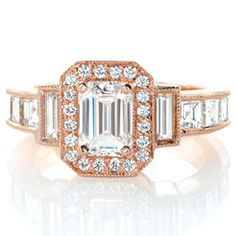 Design 3130 is an exquisite example of Art Deco style. The center 1.00 carat emerald cut diamond is framed with a micro pavé halo.  #engagement #wedding #ring http://www.knoxjewelers.biz/products/design-3130