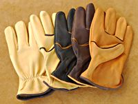 Work glove made of light weight Deerskin with contrasting welt and leather binding.