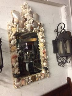 Artist handcrafted vintage Florida shells mirror with antique finish mirror  Condition: Excellent  Measurements: 25 W x 50 H x 3 D  Please