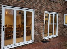 2 Sets of Master White Timber External Bifold doors finish off this new home extension. Open Plan Kitchen Living Room, Living Room White, Kitchen Doors, External Bifold Doors, White Bifold Doors, Bungalow Exterior, Door Sets, House Extensions, New Homes