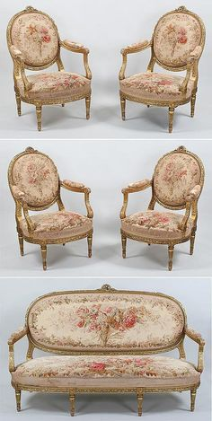 """French Louis XVI-style carved giltwood five-piece salon suite, early 20C, Francois Linke, Paris, each piece stamped """"F. Linke"""", comprised of a canape (sofa) and four fauteuils a la Reine (open armchairs), each chair with oval padded back with leaf-carved channeled frame, the crest rail surmounted by a ribbon-tied wreath with musical instruments and farm implements, the padded arms over downswept leaf-carved fluted supports flanking overupholstered horse-shoe shaped seat with reeded rails ..."""