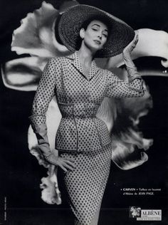 A curve hugging suit from Carven, 1954. Photo by Guy Arsac, #vintage #1950s #suits #hats #fashion
