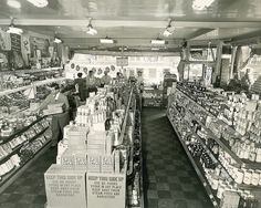Stocking the shelves of a 1940s grocery store. #vintage #supermarket #shopping