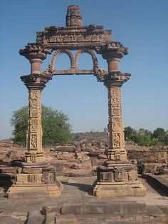 Ornately carved Hindola Torana at Gyraspur, Vidisha (Madhya Pradesh) | Dated: ~10th century CE | The remains of the entrance consist of two pillars and a beam on top of them. There is also a small ornamental beam joining the two pillars at the end. Both the beams have ornamental capitals with mythical creatures sculpted on them.