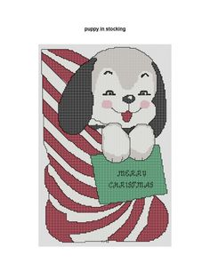 http://scout901.hubpages.com/hub/free-Christmas-cross-stitch-pattern-Puppy-in-Stocking