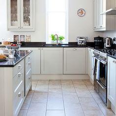 Kitchen Tiles Black Worktop kitchen: grey floor tiles with black countertops, white cabinets