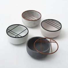 These tiny cups by German designer Hanna Kruse are topped with geometric wire grates to support and show off small objects like jewellery, flower heads or leaves.