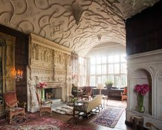 In the drawing room of designer Robert Kime's South Wraxall Manor in Wiltshire, a 17th-century Flemish tapestry balances the weight of a large stone