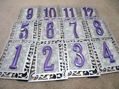 DIY table numbers... picture frames, wooden numbers (spray painted malibu) can get all supplies for dollar store or hobby lobby.