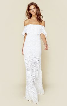 """Lacy and flirty, the Positano maxi dress features a Spanish lace fabrication with partial lining, flutter detailing with off-the-shoulder sleeves, fitted silhouette, flared tiered skirt and scalloped trim.Made in USADry clean only80% Polyamide, 15% Elastane, 5% Viscose. Lining: 90% Rayon, 10% LycraFit Guide:Model is 5ft 9 inches; Bust: 33"""", Waist: 24"""", Hips: 34""""Model is wearing a size 1Fitted silhouette"""