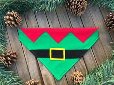 Dogs can often be our little helpers. Show off the elf-side of your dog with this elf suit slide over the color bandana. The bandana is made with green fabric and red felt for the trim with a black felt belt and yellow felt belt buckle. Christmas Animals, Christmas Dog, Christmas Gifts, Xmas, Dog Clothes Patterns, Coat Patterns, Dog Crafts, Idee Diy, Dog Items