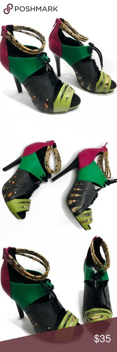 Multi Colored Printed H&M Divided Heels Size 6 Turn heads at your next party with these perfectly sexy heels. The playful colors give your look a unique edge, so you can pair them with a simple mini dress and still make a big statement.  🎁Features: Sexy & Comfortable   🎁Coloring: Black, Green, Pink, Brown, Lime Green, White  🎁Fit: 6-6.5  🎁Condition: Never Worn, Slight Paint Chipping When Brought  Offers✅ Bundle Deals✅ Trades❌ H&M Shoes Heels
