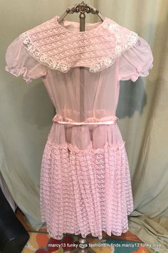 It is semi-sheer, nylon full skirted dress. It has a wide, lace trimmed white collar. The waist is fitted & has two small belt loops in front, & a satin ribbon sash belt. The under layer of the full skirt is tulle with a ruffled hem. | eBay!