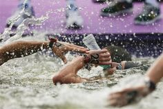 Alex Meyer of the U.S. drinks as he competes in the men's 10km swimming marathon.