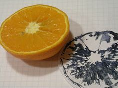 Kirsten K Christensen, Denmark - Fruit print: Prepare paper with thin coat of acrylic. Slice orange. Place cut side on painted paper. Translation problem: Either dry the orange a few hours before printing OR leave orange slice on paper a few hours to dry.