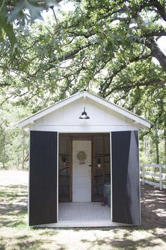 Chicken Coop Plans Free 143411569371964356 - Storage section in front Fancy Farmhouse DIY Chicken Coop Reveal – Southern Revivals Source by junkaholic Inside Chicken Coop, Chicken Fence, Cute Chicken Coops, Best Chicken Coop, Backyard Chicken Coops, Chickens Backyard, Chicken Feeders, Chicken Houses, Small Chicken