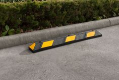 The R-2004 parking stop increases parking lot safety by preventing vehicle intrusion onto curbs, pedestrian zones, gardens, and other sensitive areas. Parking stop placement encourages safer, more predictable driving. To learn more, visit: http://www.reliance-foundry.com/traffic-safety-supplies/parking-stops/r-2004-parking-stop