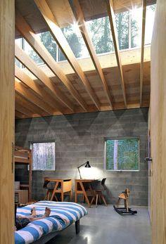 Ono Architectuur, Waasmunster House, Waasmunster, Belgium. photo © Filip Dujardin. Concrete blockwork, exposed timber rafters, roof light. kids room.