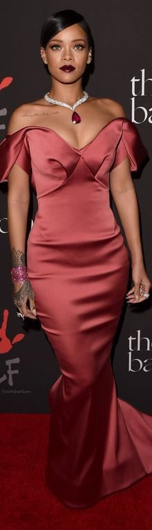 Who made Rihanna's pink off the shoulder gown and jewelry that she wore in…