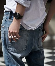 Pearl rings and boyfriend jeans.