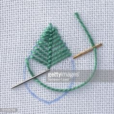 Stock Photo : Leaf shape stitched on fabric, close-up