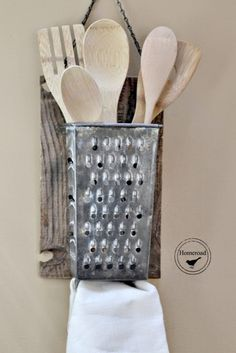 Use a vintage cheese grater and an old board to create a rustic utensil holder to hang on the wall. - Charming Farmhouse Kitchen DIYs