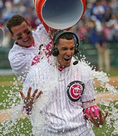 Javier Baez #9 of the Chicago Cubs is doused with water by Anthony Rizzo #44 after hitting a game-winning, walk off home run against the Washington Nationals at Wrigley Field on May 8, 2016 in Chicago, Illinois. The Cubs defeated the Nationals 4-3 in 13 innings.