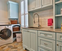 We could paint your laundry cabinetry Silver Strand. This is Sherwin Williams Aviary Blue which is similar. This floor looks like the colors of your floor.