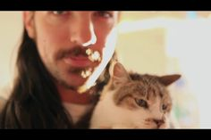 Seth Avett and his cat.