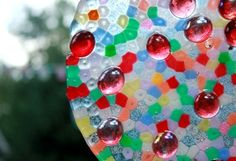 melted pony bead suncatcher with glass stones embedded  THIS IS SO SO COOL FOR HANGING GARDEN ART:)))