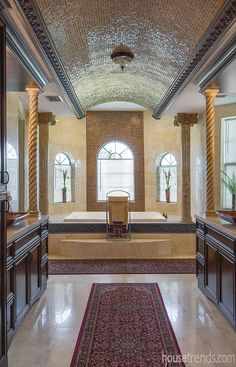 Glass mosaic tile covers a barrel vault ceiling
