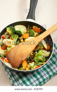 Fried vegetables in a griddle Stock Photo Fried Vegetables, Griddles, Griddle Pan, Fries, Stock Photos, Grill Pan