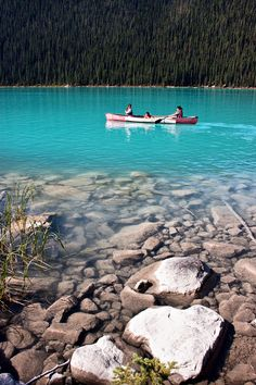 Canoeing On Lake Louise | Banff National Park, Canada - If you love this beautiful picture, like it. We post stuff just like this every day on Facebook. Like us by clicking here: http://on.fb.me/1bgLOYJ - You won't regret it.