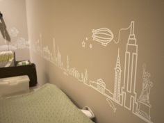 OoOo Maybe vinyl decals might work -- create line drawings of places you've been and make them into vinyl cutouts....