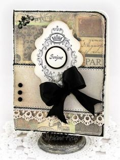 Paris...  Stephanie Kraft has a FAB Bonjour Shabby Chic Card using Labels Twenty. I just love that great black velvet bow combined with the lace and all the stitching...