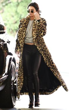 Kendall Jenner in a long leopard coat, black jeans and booties - click ahead for more celebrity winter outfits!