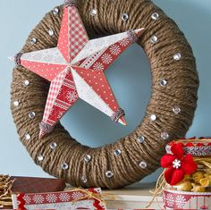 Create a simple and country chic wreath with yarn, Mod Podge and Podgeable papers!