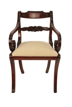 English Regency Style Mahogany Carved Arm Chair with a Rolled Arm Design. Slip seat cushion. Priced in C.O.M. Custom made by Agostino Antiques. Available in select wood tone finishes and any Benjamin Moore Paint Color finish.