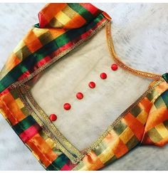 List of designer blouses whose designs will be ruling the markets this year. Go get shopping for these trendy fancy saree blouse back neck designs. Blouse Designs Catalogue, Kids Blouse Designs, Simple Blouse Designs, Stylish Blouse Design, Saree Blouse Neck Designs, Indian Blouse Designs, Style Sportif, Designer Blouse Patterns, Costume