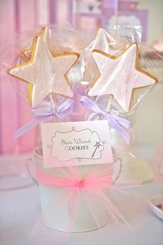 Love the ideas from this princess party especially the tulle hanging Pom poms, crown sandwiches, and star wand cookies.