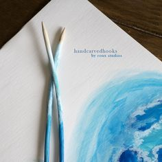 Inspired by the ocean, these hand carved birch knitting needles were carved as a set and then painted with the splashing beauty of the Pacific Ocean.