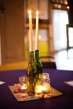 easy peasy DIY centerpieces - old wine bottles, mason / ball jars, tealights, scrapbook paper and fake flower petals...