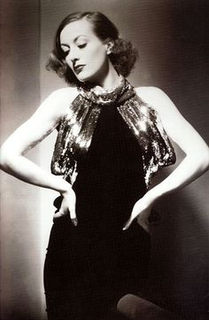 Joan Crawford in an Adrian design for the 1934 movie Sadie Mckee - I liked her in this era before she got too extreme with the eyebrows.