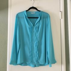 Long sleeve teal blouse Sleeves are adjustable with attached button Tops Blouses