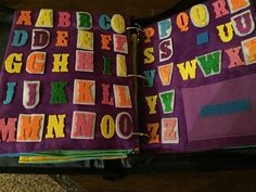 My Quiet Book - Boy, pages 13-14, Learning the Alphabet.  The envelope is to contain 3-letter words that are to be copied.