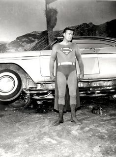 George Reeves as Superman lifting a 1957 Plymouth.