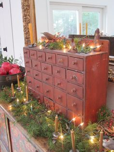 Early 1800s Red Paint 26 Drawer Hanging Apothecary Chest Dressed for Christmas.
