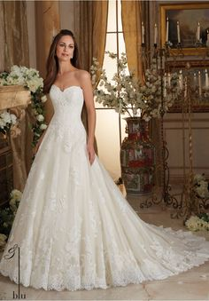 Wedding Gowns By Blu featuring Chantilly and Embroidered Lace on Tulle Ball Gown with Scalloped Hemline Available in Three Lengths: 55', 58', 61'. Colors Available: White, Ivory, Ivory/Champagne